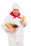 Smiling cook man holding pan filled with raw macaroni wearing wh Stock Photo