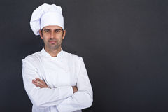 Smiling cook. Over dark background Stock Image