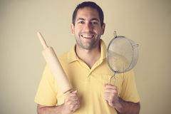 Smiling, cooking man holding utensils Royalty Free Stock Images