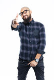 Smiling cool bearded african man in glasses pointing to camera Stock Images