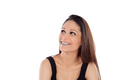 Smiling cool girl with brackets looking up Stock Images