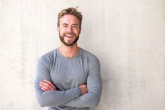 Smiling cool guy with arms crossed Stock Photo
