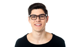 Smiling cool handsome young guy in eyeglasses Stock Photography