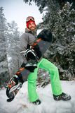 Smiling young man snowboarder Stock Photo