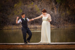Smiling Cople Dancing Over Pond Stock Photography
