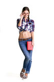 Smiling coquettish girl. In big glasses, casual clothes and naked belly holding book and standing isolated on white stock photos