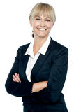 Smiling corporate head posing with folded arms Stock Photography