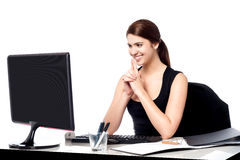 Smiling corporate lady in her office Royalty Free Stock Images