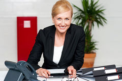 Smiling corporate lady holding wireless tablet Stock Photography
