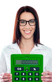 Smiling corporate lady showing green calculator Royalty Free Stock Photos