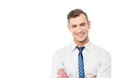 Smiling corporate man with folded arms Royalty Free Stock Image
