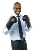 Smiling corporate man wearing boxing gloves Stock Photography