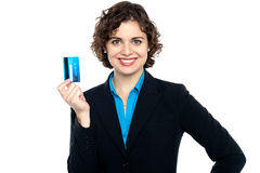 Smiling corporate woman holding credit card Stock Photos