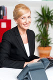Smiling corporate woman in office Stock Photography