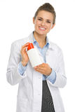 Smiling cosmetologist woman with sun screen creme Stock Photography