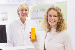 Smiling costumer with a medicine bottle Royalty Free Stock Image