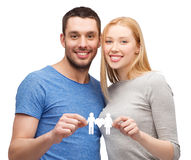 Smiling coule holding paper family with heart Stock Images