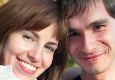 Smiling couple. In the forest, close-up Royalty Free Stock Images