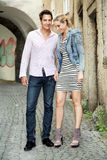 Smiling Couple. Young smiling couple in the old city royalty free stock photos