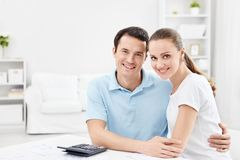 Smiling couple. Young smiling couple at home stock photo