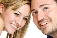 Smiling Couple. Isolated smiling young couple closeup stock images