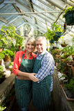 Smiling couple amidst plants at greenhouse Stock Photography