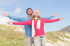 Smiling couple with arms wide open Stock Photo
