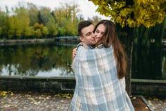 Smiling couple in autumn park Stock Photos