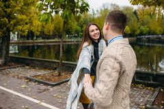 Smiling couple in autumn park Royalty Free Stock Photo
