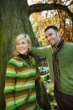 Smiling couple on autumn walk Royalty Free Stock Images
