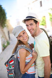 Smiling couple of backpackers visiting old town Royalty Free Stock Image