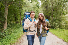 Smiling couple with backpacks hiking Stock Image
