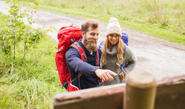 Smiling couple with backpacks hiking Royalty Free Stock Image