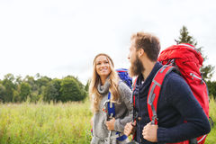 Smiling couple with backpacks hiking Royalty Free Stock Photos