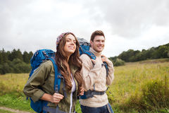 Smiling couple with backpacks hiking Stock Photography