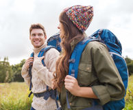 Smiling couple with backpacks hiking Royalty Free Stock Images