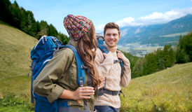 Smiling couple with backpacks hiking Stock Photo