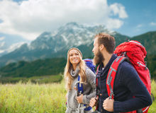 Smiling couple with backpacks hiking Stock Photos