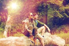 Smiling couple with backpacks in nature Stock Images
