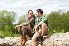 Smiling couple with backpacks in nature royalty free stock photography