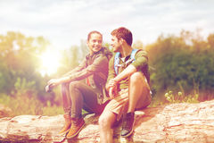 Smiling couple with backpacks in nature Stock Image