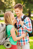 Smiling couple with backpacks in nature Royalty Free Stock Photo