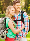 Smiling couple with backpacks in nature Royalty Free Stock Photos