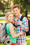 Smiling couple with backpacks in nature Royalty Free Stock Image