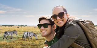 Smiling couple with backpacks traveling in africa Royalty Free Stock Photo