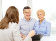 Smiling couple at bank. Finance, bank, family and business concept - smiling couple at bank stock images