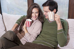 Smiling couple in bed Stock Image