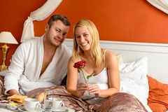 Smiling couple bed breakfast celebrating Valentine's Royalty Free Stock Photo