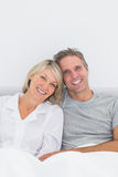 Smiling couple in bed Stock Photography