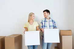 Smiling couple with big boxes moving to new home Royalty Free Stock Photography